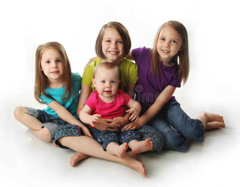 Four young adorable sisters royalty free stock image