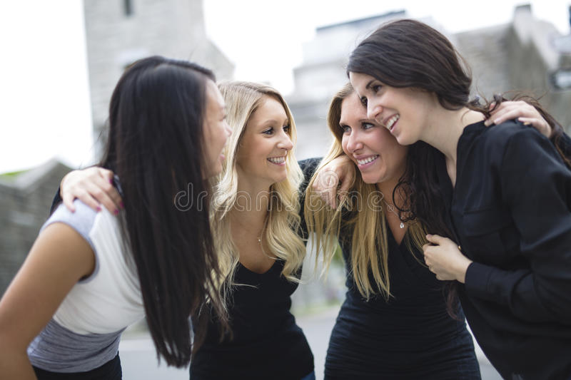Four young good girl friend people in the city stock photo