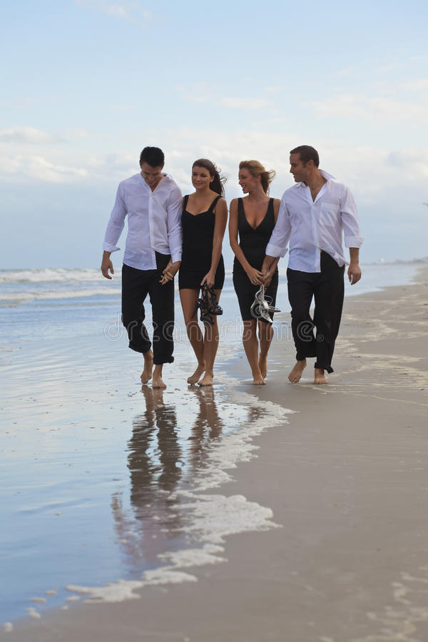 Download Four Young People, Two Couples, Walking On A Beach Stock Images - Image: 16401544
