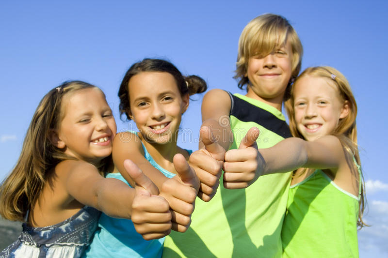 Download Four young positive kids stock image. Image of approved - 10915467