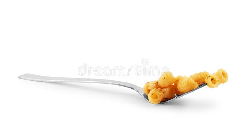Fourchette avec les pâtes savoureuses sur le fond blanc photo stock