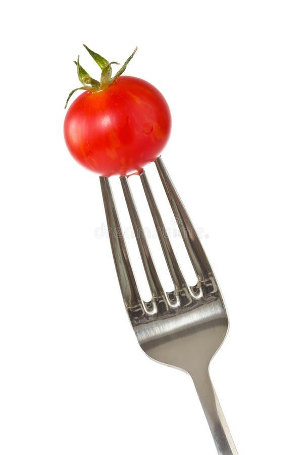 Fourchette avec une petite tomate rouge photo libre de droits