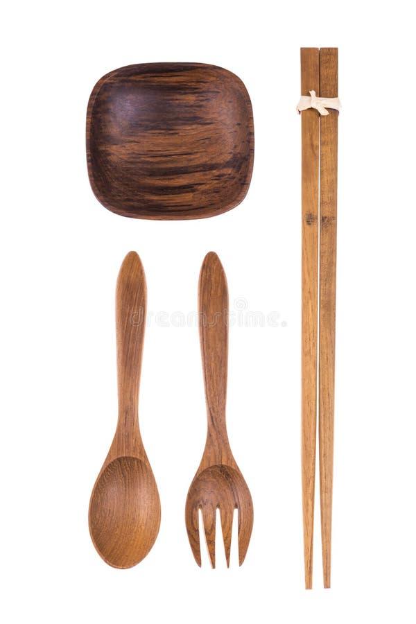 Fourchette en bois naturelle, cuillère, baguettes et petite cuvette photo stock