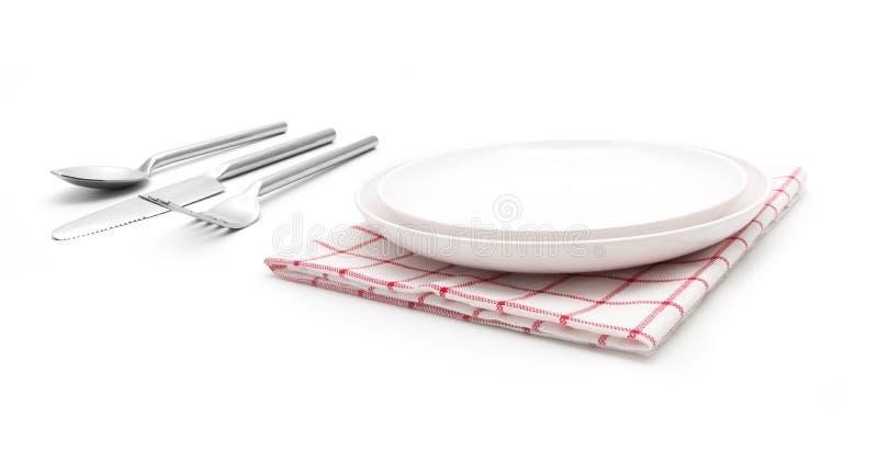 Fourchette et couteau sur la serviette rouge images libres de droits