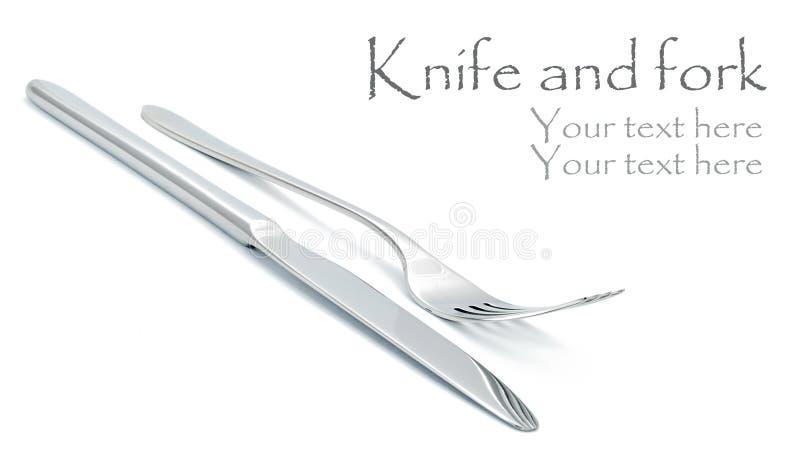 Fourchette et couteau sur le blanc photos libres de droits