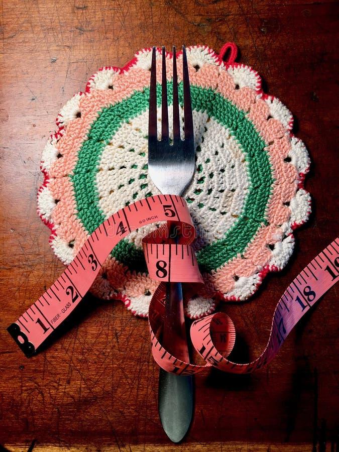 Fourchette et ruban métrique photographie stock