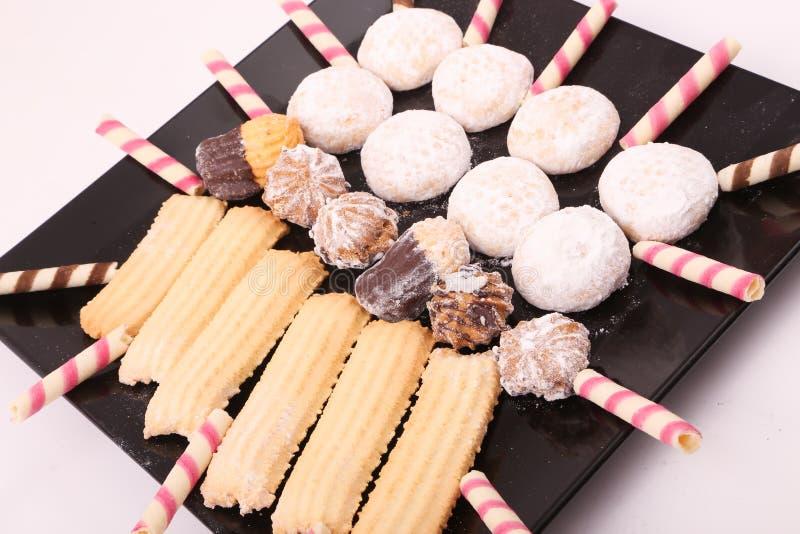 Fours, tortas y galletas de Petits fotografía de archivo libre de regalías