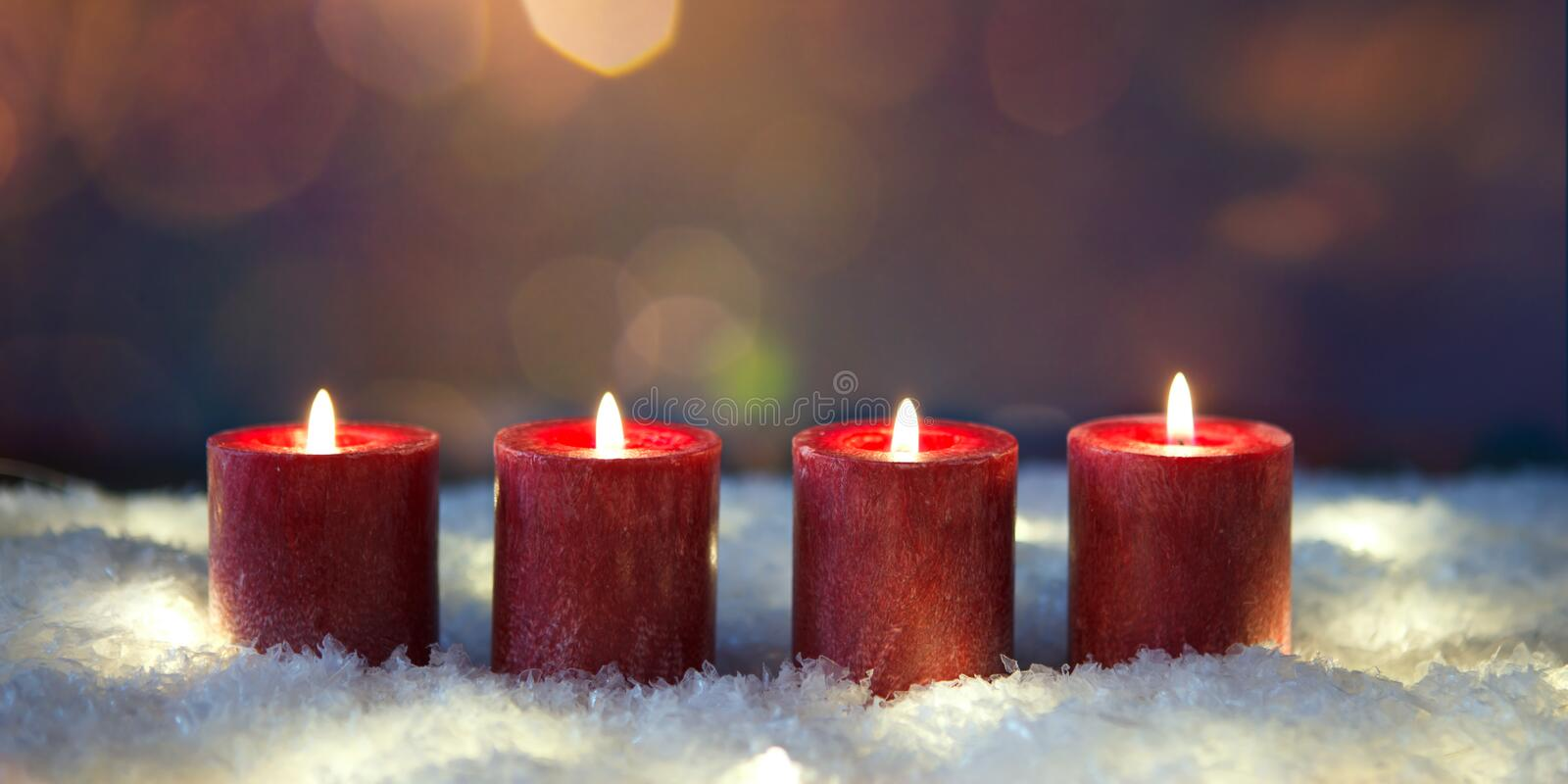 Fourth advent four candles burning stock photography