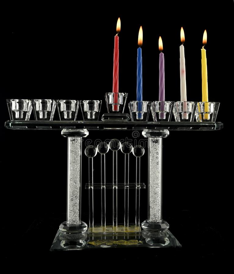 The fourth  day Hanukkah menorah crystal lamp. The fourth, day Hanukkah menorah crystal lamp that is lit for eight days of Hanukkah on a black background stock photography