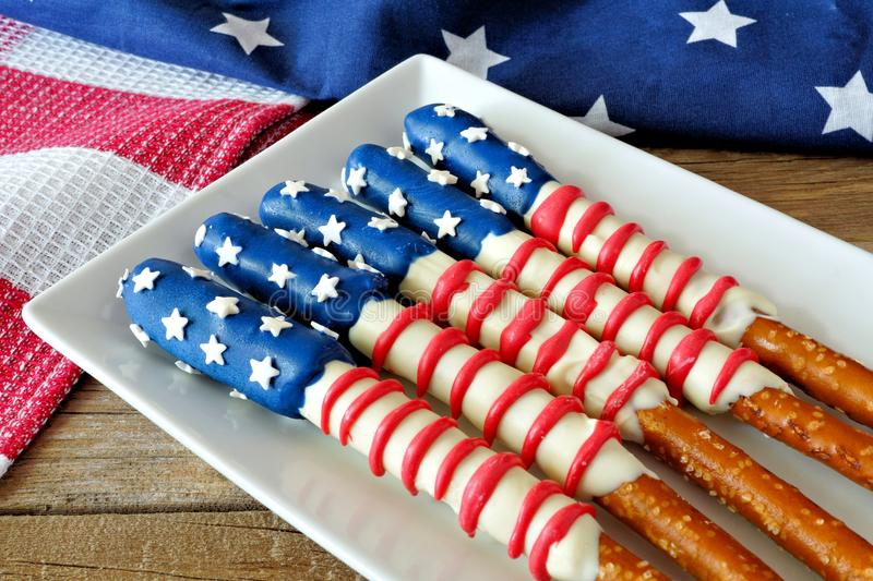 Fourth of July American flag pretzel rods on plate. Fourth of July American flag themed pretzel rods on plate with holiday decor royalty free stock photo
