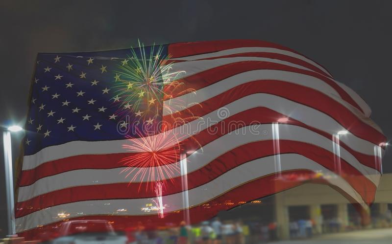 Fourth of July Fireworks display with the American Flag overlay copy space stock photo