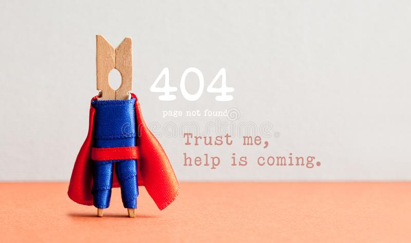 Fout 404 pagina gevonden niet Web-pagina Stuk speelgoed superhero van de wasknijperpin, doorboort grijze achtergrond Vertrouw op  royalty-vrije stock afbeelding