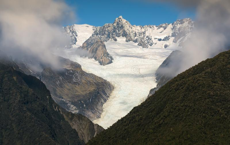 Fox glacier New Zealand scenic mountain landscape stock photo