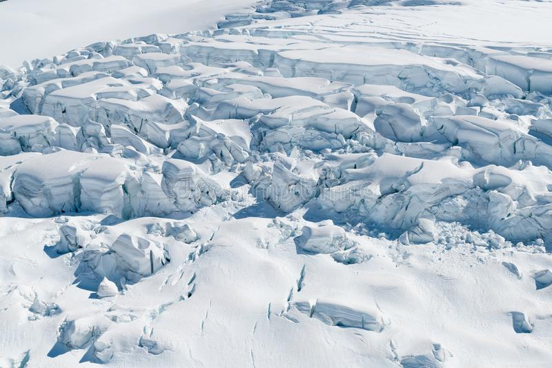 Fox glacier snow close up view from helicopter. New Zealand winter season natural landscape royalty free stock photo