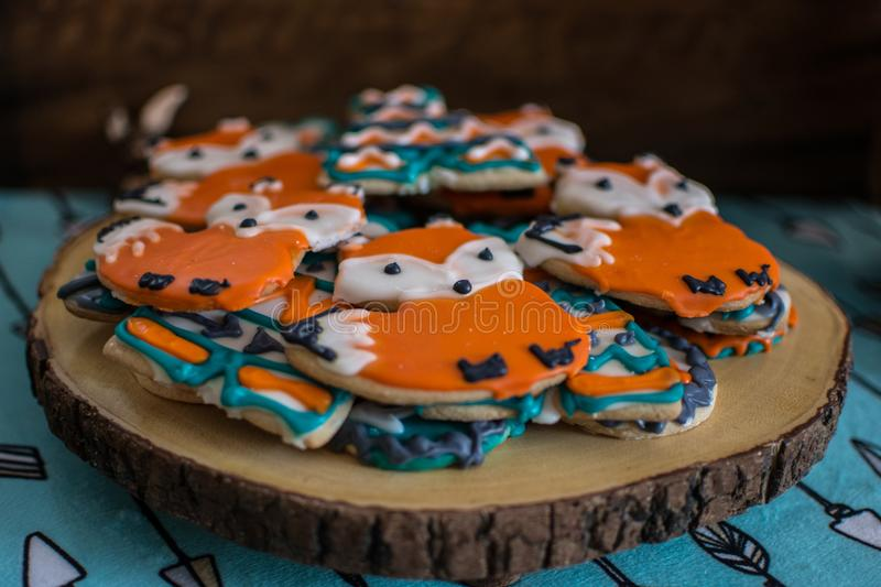 Fox and teepee cookies for an animal and outdoor adventure theme baby shower. Fox cookies, teepee cookies, animal theme and decorations for an outdoor adventure royalty free stock images