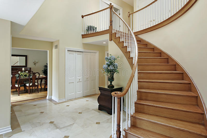 Download Foyer With Curved Staircase Stock Image - Image of residence, room: 12655747