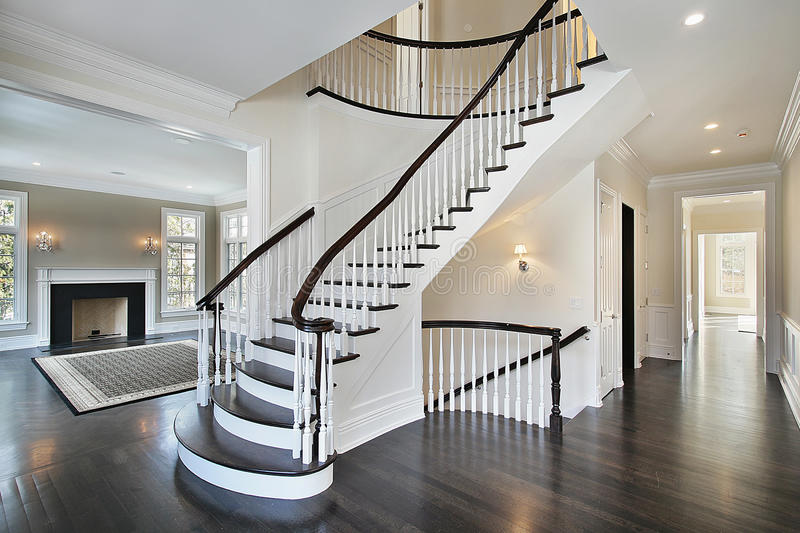 Foyer with curved staircase stock photo image of for Hall entree avec escalier
