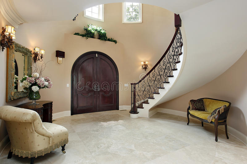 Foyer with curved staircase. Foyer in luxury home with curved staircase stock photos
