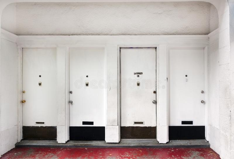 Foyer and four apartment building doors. royalty free stock image