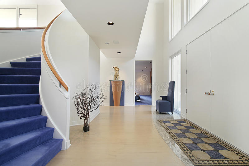 Foyer with spiral staircase stock images