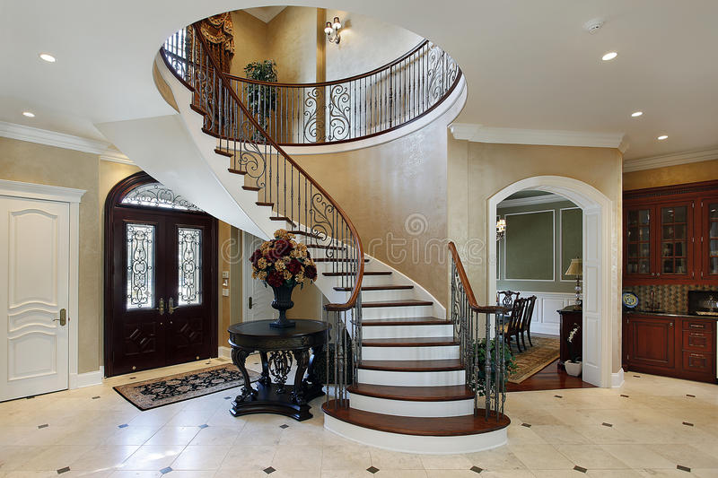 Foyer with spiral staircase stock photography