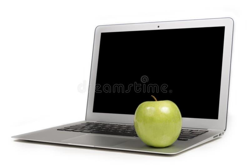 Foyer sur Apple vert sur un ordinateur portable photo stock