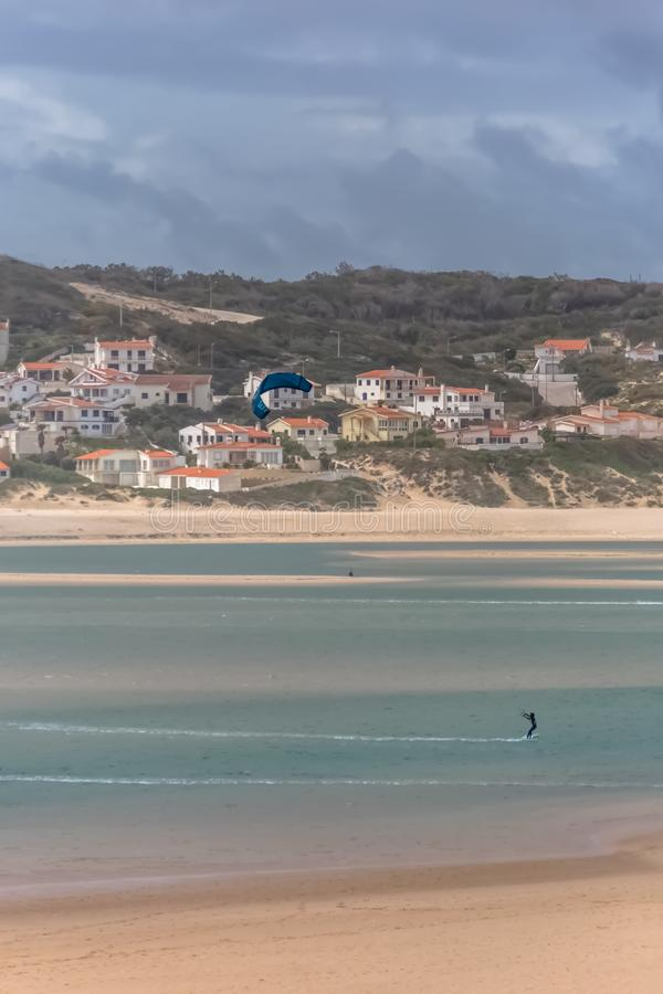 View of a professional sports practicing extreme sports Kiteboarding at the Obidos lagoon. Foz do Arelho / Leiria / Portugal - 04 04 2019 :View of a professional stock photography