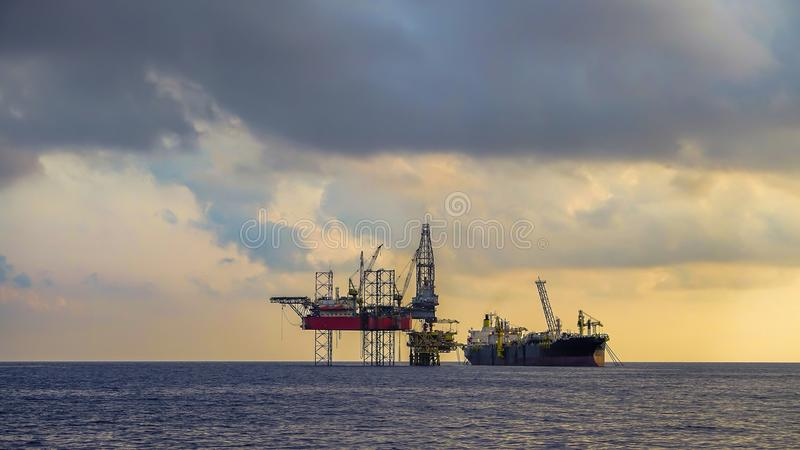 Offshore drilling rig and FPSO ship photography. FPSO and drilling rig in offshore oil field stock photography