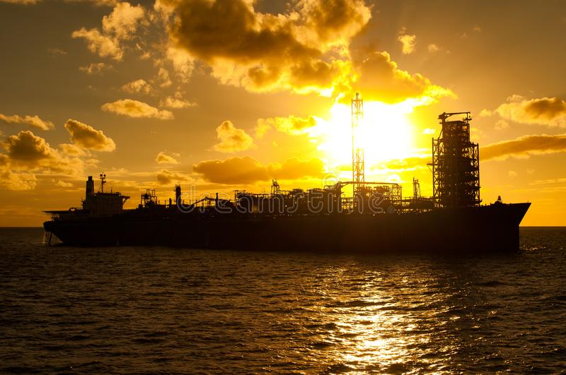 FPSO oil rig vessel at sunset/sunrise. Floating at sea, Campos Basin, Rio de Janeiro, Brazil stock image