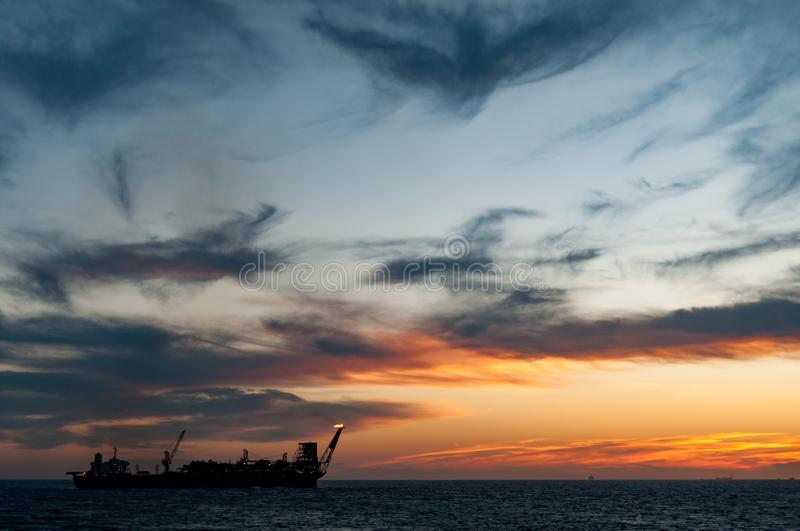 FPSO oil rig vessel at sunset/sunrise. Floating at the ocean, Campos Basin, Rio de Janeiro, Brasil royalty free stock images