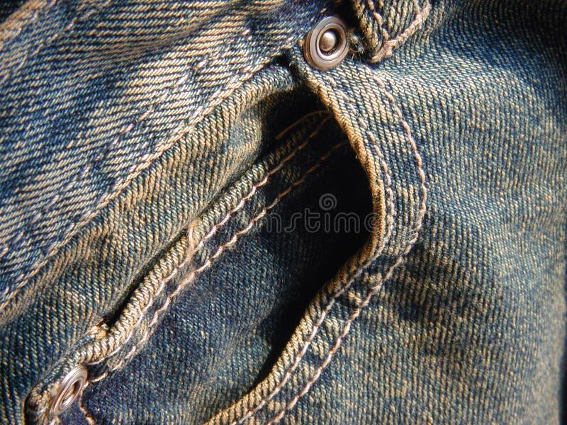 främre jeansfack arkivfoton