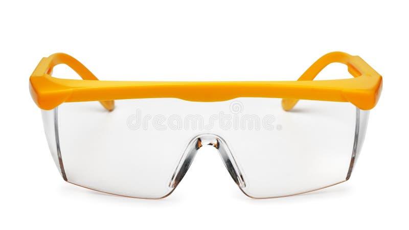 Främre sikt av gul plast- säkerhetsskyddsglasögon arkivfoton
