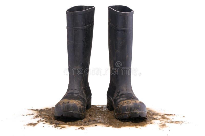 Främre sikt för leriga gummistöveler royaltyfri foto