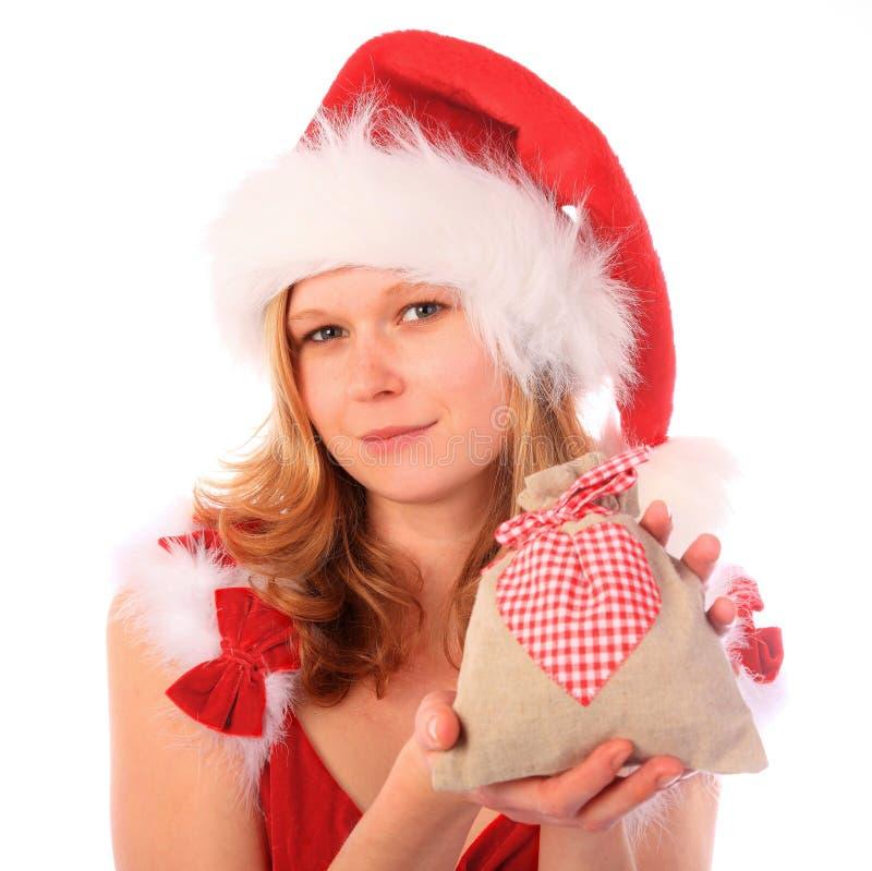 Fräulein Sankt hält einen fantastischen Geschenk-Beutel an stockbilder