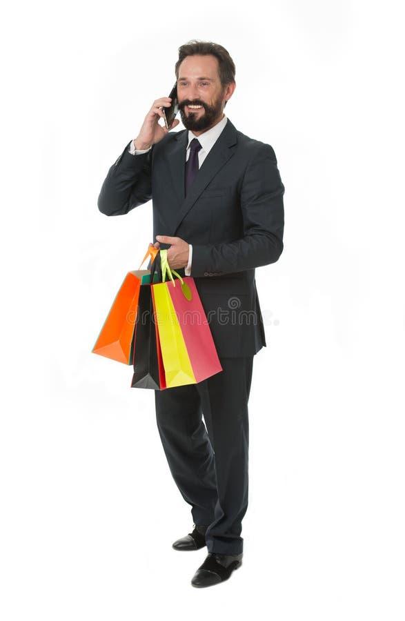 Fråga levererar dina köp Affärskommunikationer Upptaget med konversation För dräkthåll för affärsman formellt papper för grupp fotografering för bildbyråer