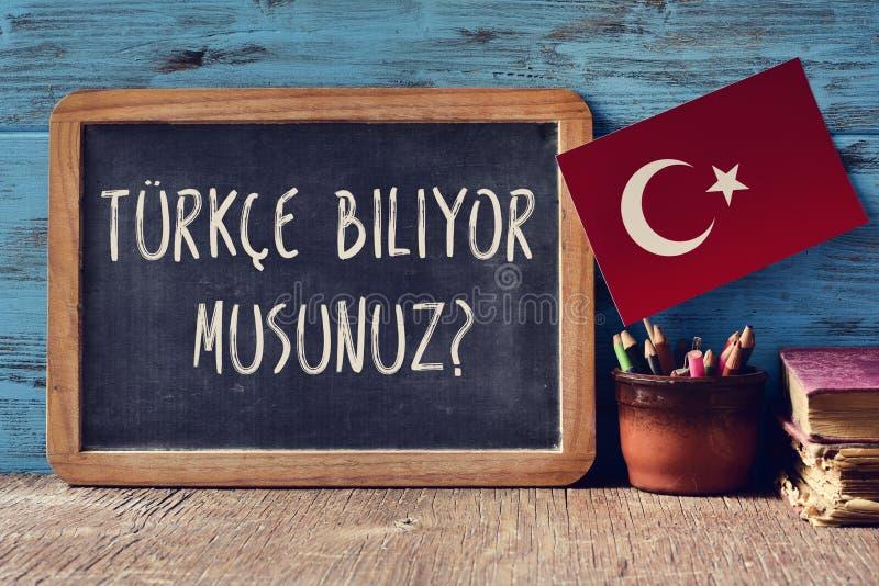 Frågan talar du turk? skriftligt i turk fotografering för bildbyråer