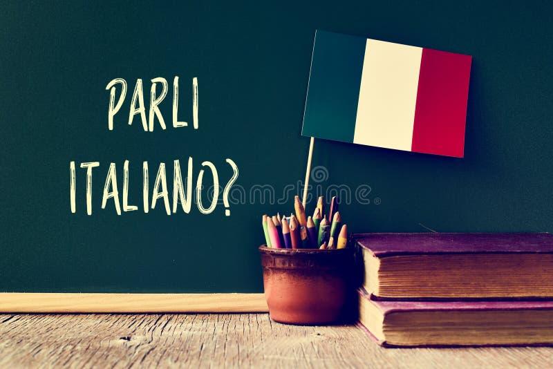 Frågeparliitaliano? talar du italienare? royaltyfria foton