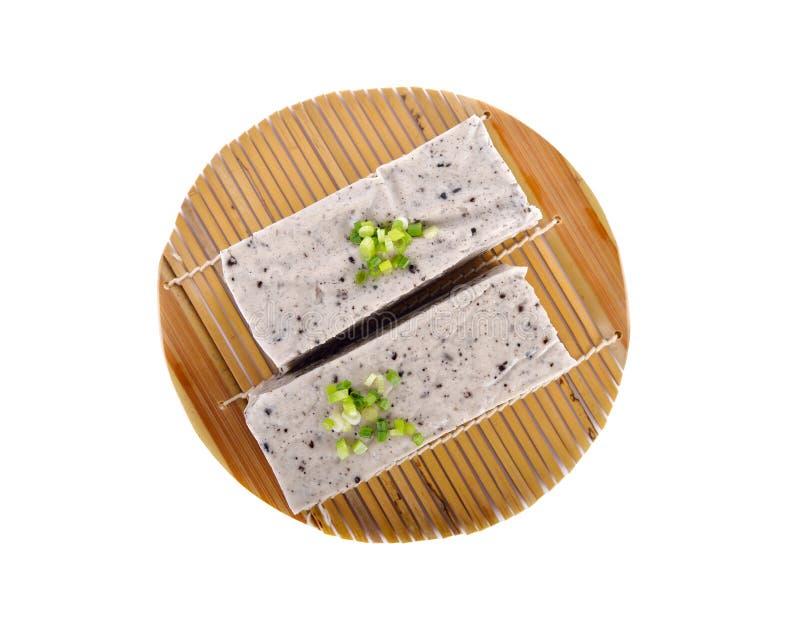 Frö för sesam för Tofublandningsvart på bambu som är matt med vit bakgrund arkivbilder