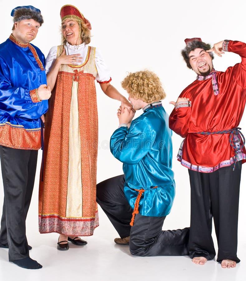 Fröhliche Schauspieler im Kostüm stockfoto