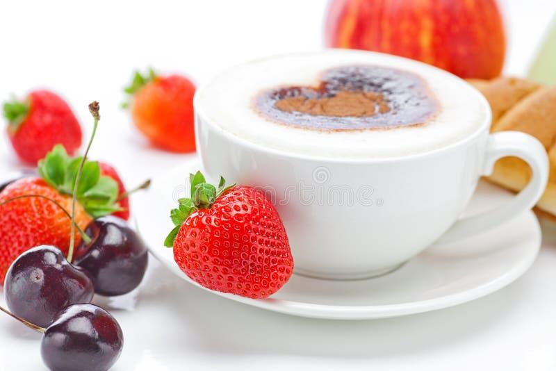 Früchte und Cappuccino lizenzfreie stockfotografie