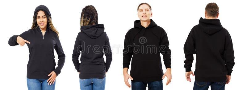 Fr?mre baksida och bakre svart tr?jasikt Härlig svart kvinna och man i mallkläder för tryck- och kopieringsutrymme som isoleras p royaltyfri bild