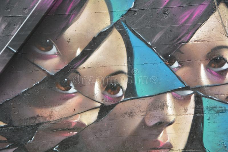 Fractured female face graffiti in SE Portland, Oregon royalty free stock photo