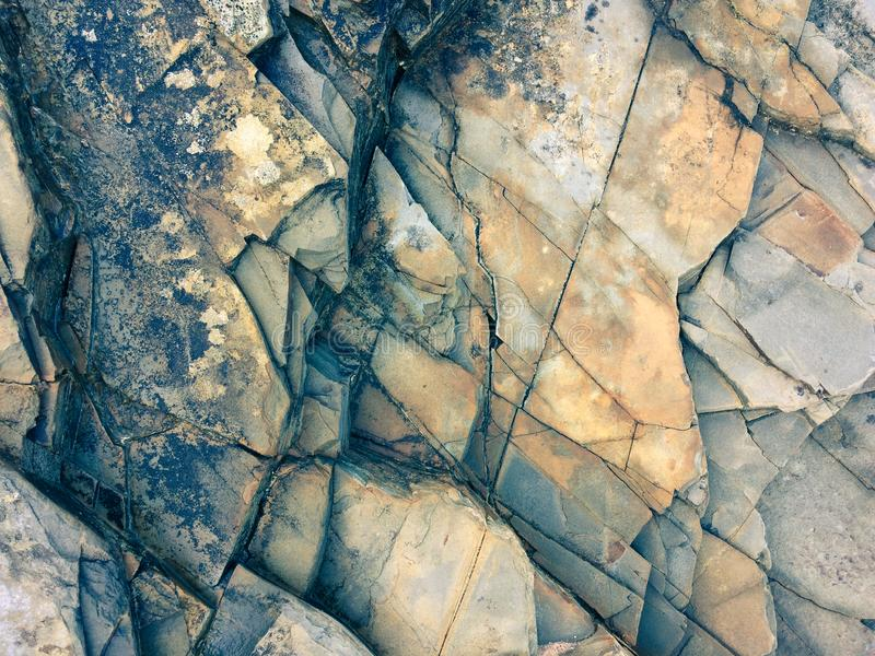 Fractured rock strata, cracked rock, stone texture, many cracks in the stone, fractured rock stock photo