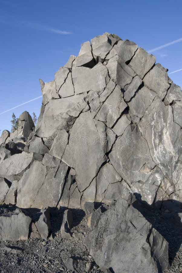 Fractured Rockface. Against a bright blue sky. Near McKenzie Summit at view point, Oregon stock image