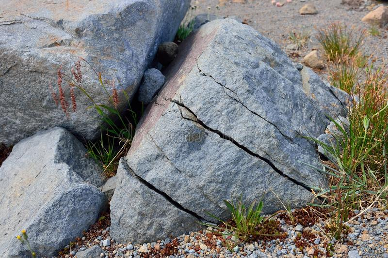 Fractured rocks. By freezinf water royalty free stock images
