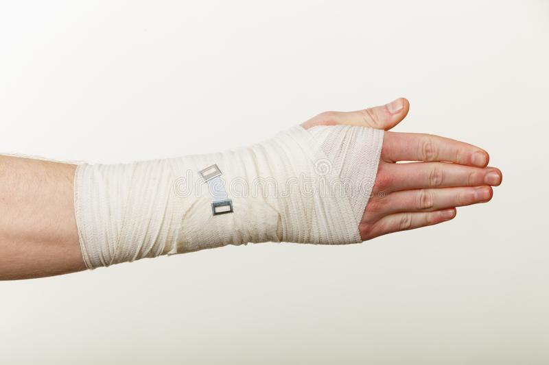 Male hand in bandage. stock photos
