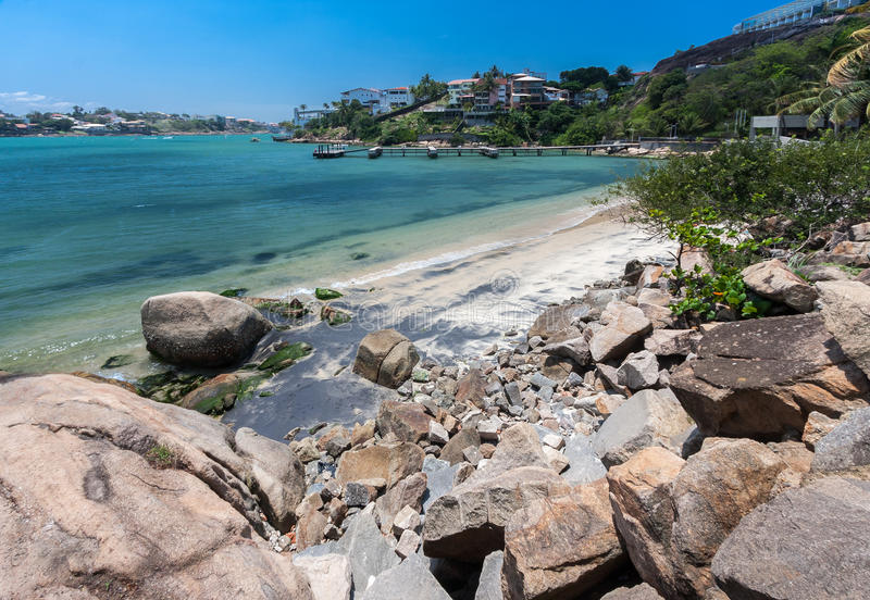 Frade Island Vitoria. The green waters of the Atlantic Ocean and Praia do Canto with its buildings at the shore from Frade Island. Vitoria, Espirito Santo stock image