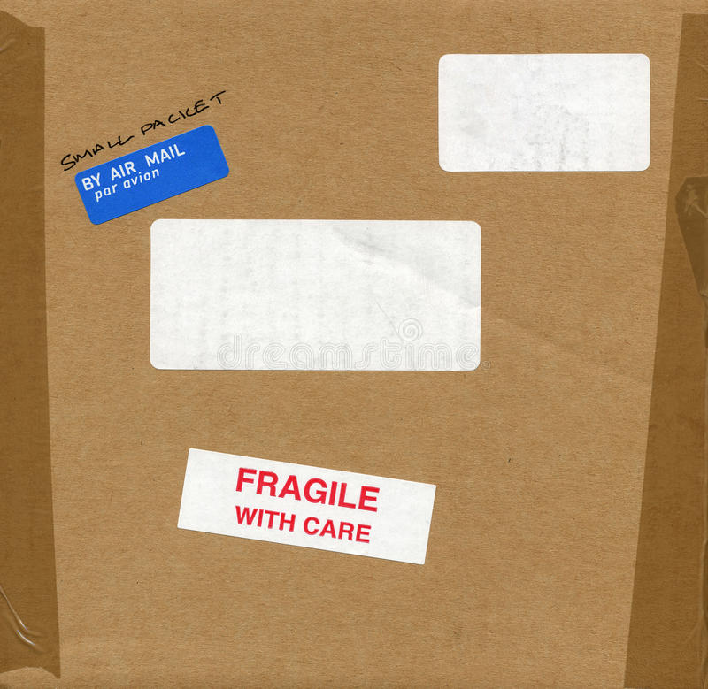 Fragile with care sign. Fragile with care warning sign label tag on a cardboard box packet stock image