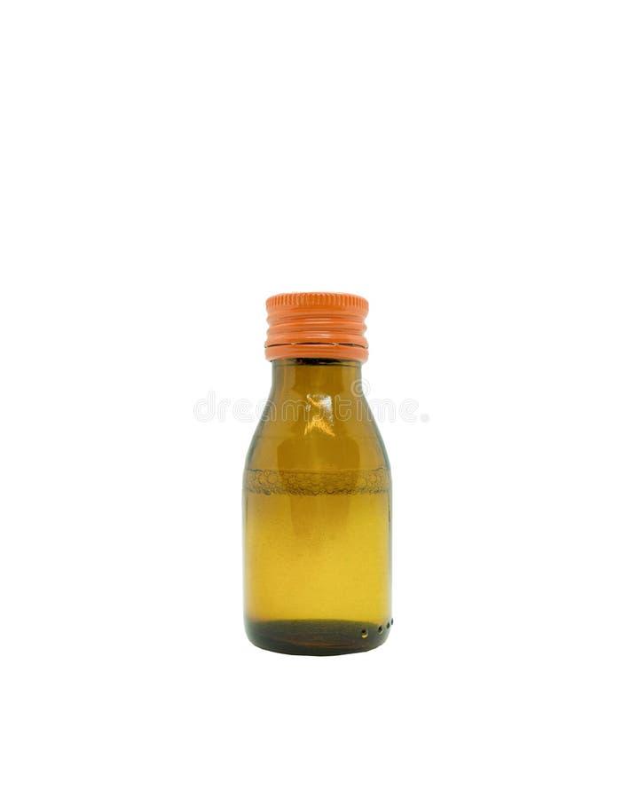 fragile en verre opaque de chapeau orange de bouteille de drogue de médecine sur d'isolement photographie stock libre de droits