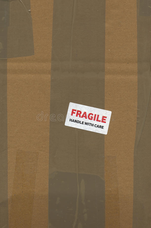 Fragile handle with care. Label on a corrugated cardboard packet stock image